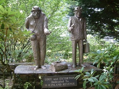 Loot and Extortion. Statues at Trago Mills, poking fun at the Inland Revenue.