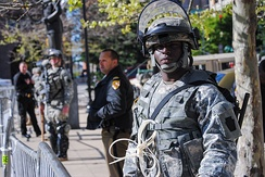 A soldier from 1st Battalion, 175th Infantry Regiment keeps watch in front of Baltimore City Hall on April 28