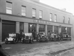 An array of Morris cars on the forecourt of Mr J. Kelly's garage at Catherine Street, Waterford, Ireland, 1928