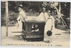 Male servants carrying a palanquin and female maid with a traditional fan (Korea c. 1904)