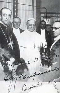 Pius XI (center) with Cardinal Pacelli (front left), the radio transmission pioneer Guglielmo Marconi (back left) and others at the inauguration of Vatican Radio on 12 February 1931