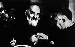 Padre Pio helped by other friars