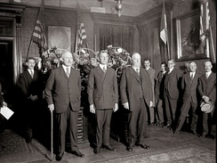 Swearing in of Dwight F. Davis as Secretary of War in 1925. Former Secretaries John W. Weeks and Chief Justice William Howard Taft are standing beside him.