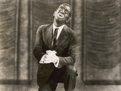 Al Jolson in The Jazz Singer, the first feature film to include scenes of fully synchronized sound that is also known for its controversial use of blackface.