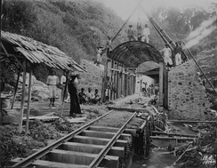 Workers pose at the site of a railway tunnel under construction in the mountains, 1910.