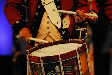 A drummer of the Old Guard Fife and Drum Corps with a Snare Drum.