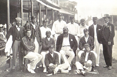 England team v. Australia, Trent Bridge 1899.  Back row: Dick Barlow (umpire), Tom Hayward, George Hirst, Billy Gunn, J T Hearne (12th man), Bill Storer (wkt kpr), Bill Brockwell, V A Titchmarsh (umpire).  Middle row: C B Fry, K S Ranjitsinhji, W G Grace (captain), Stanley Jackson.  Front row: Wilfred Rhodes, Johnny Tyldesley. Jackson, Hirst and Rhodes are wearing their Yorkshire caps.