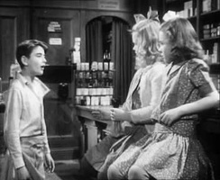 Young George (Bobby Anderson) with Violet and Mary in Mr. Gower's drugstore