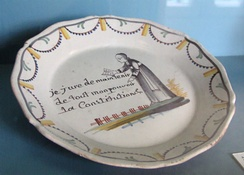 A commemorative plate from 1790 shows a curé swearing to the Constitution.