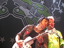 Johan Frandsen and Brian Setzer on stage at the Helsinki Ice Hall, Finland, July 2011.