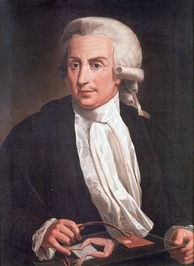 Painting of a middle-aged man sitting by the table, wearing a wig, black jacket, white shirt and white scarf.