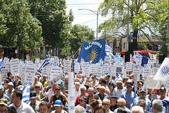Macedonian Greeks protest in a rally in Melbourne in April 2007, holding signs descriptive of the historical concerns around the naming dispute and others with the Vergina sun.