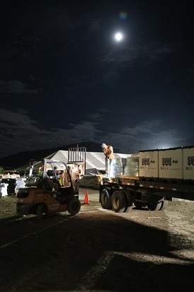 Members of the New York Guard load supplies onto a flatbed as a part of the State Active Duty mission in the Fall of 2017 Hurricane Maria deployment.