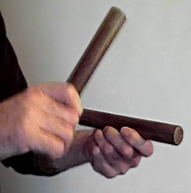 Playing a pair of claves