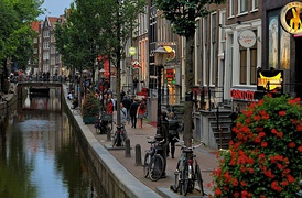 De Wallen, Amsterdam's red-light district, offers activities such as legal prostitution and a number of coffee shops that sell marijuana. It is one of the main tourist attractions.