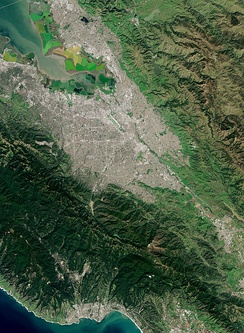 A satellite image of the Santa Clara Valley in the South Bay Area; San Jose makes up most of the urbanization in the center of the valley.