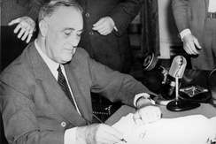President Roosevelt signing the Selective Training and Service Act of 1940, September 16, 1940.