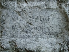 A Roman inscription at the castle hill of Trenčín in Slovakia (178–179 AD). Text: Victoriae Augustorum exercitus, qui Laugaricione sedit, mil(ites) l(egiones) II DCCCLV. (Maximi)anus leg(atus leg)ionis II Ad(iutricis) cur(avit) f(aciendum) (Done by 855 Legionaries of the Augustus victorious army, who are stationed in Laugaricio. Done under supervision of Maximus legatus of II legion.)