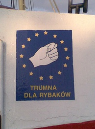 """Trumna dla rybaków"" (""Coffin for fishermen""). A sign visible on the sides of many Polish fishing boats. It depicts an obscene Slavic gesture. Polish fishermen protest against the EU's prohibition of cod fishing on Polish ships."