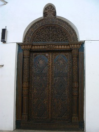 A carved door with Arabic calligraphy in Zanzibar