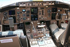 The early 767 flight deck with EFIS and EICAS screens allowed two-crew operations, later 767-400 had larger displays, while earlier models could be upgraded