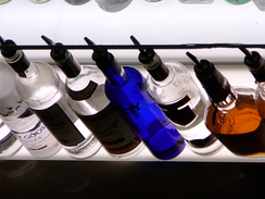 A row of alcoholic beverages – in this case, spirits – in a bar