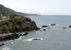 The Bristol Channel coast at Ilfracombe, North Devon, looking west towards Lee Bay, with Lundy in the distance