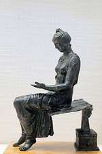 Left image: Roman fresco of a blond maiden reading a text, Pompeian Fourth Style (60–79 AD), Pompeii, Italy Right image: Bronze statuette (1st century AD) of a young woman reading, based on a Hellenistic original