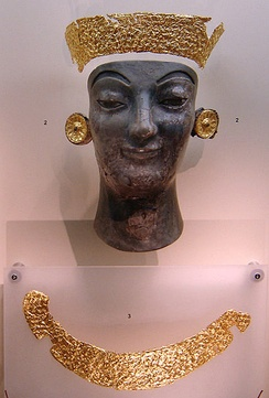 Gold and fire-blackened ivory fragments of a burnt Archaic chryselephantine statue - Delphi Archaeological Museum