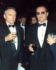 Dennis Hopper and Jack Nicholson wearing tuxedos and holding drinks