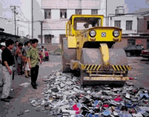 Falun Gong books are destroyed following announcement of the ban in 1999.