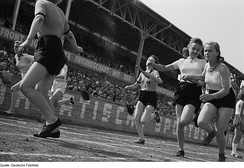 Girls handing over the baton in a relay race in Leipzig in 1950