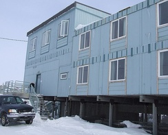 Adfreeze piles supporting a building in Barrow, Alaska