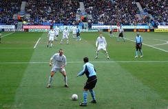 Fulham playing in their light blue away kit against Bolton Wanderers in the 2004–05 FA Cup.