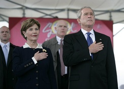 George W. Bush at the christening of the USS George H.W. Bush supercarrier in 2006