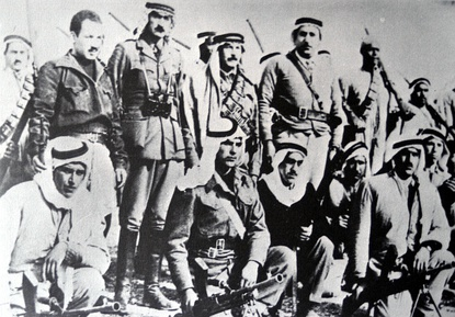 Abd al-Qadir al-Husayni returned to Palestine after an exile of ten years, and began organizing Palestinian resistance to forcible partition of the country. He is seen here (standing center) with aides and Palestinian irregulars, Jerusalem district, February 1948