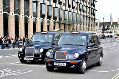 Two black London taxis, also known as a hackney carriage