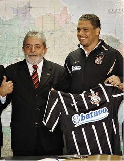 Ronaldo during his Corinthians unveiling in 2009, with Brazil president Lula handing him the jersey.