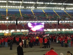 The big screen and some of the fans just after the doors opened for the semi-final between Wales and France