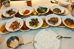 The hidang style Padang food served at Sederhana restaurant, all of the bowls of food are laid out in front of customer, the customer only pays for whichever bowl they eat from.