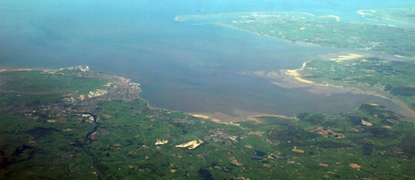 A panorama of most of Morecambe Bay looking from East (bottom of photo) to West (top of photo). Barrow-in-Furness and Walney Island can be seen in the upper part of the photo and Lancaster and Morecambe are visible in the lower left-hand corner of the photo.