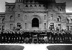 Royal Canadian Naval Volunteer Reserve members stand outside the provincial legislature in 1914.