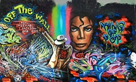 A wall with colorful graffiti depicting Michael Jackson; once his full body dancing, then a close-up of his face.