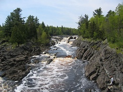 Tilted beds of the Middle Precambrian Thomson Formation in Jay Cooke State Park[16]
