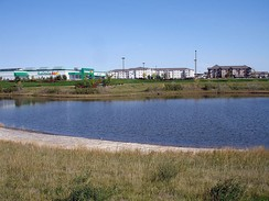 A retention pond for treatment of urban runoff (stormwater).