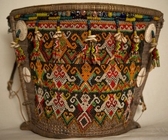 Dayaks carry their babies in baskets or carriers such as this one. The motifs on the beaded panel and the additional embellishments such as shells, claws etc. are meant for the protection of the child. Courtesy of the Wovensouls Collection, Singapore