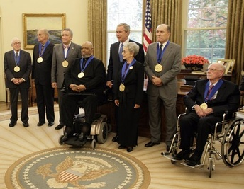 U.S. President George W. Bush stands with recipients of the 2005 National Medal of Arts on 9 November 2005, in the Oval Office.