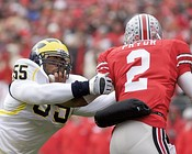 Pryor attempts to elude Brandon Graham during 2008 Michigan – Ohio State rivalry game (left) and O'Brien Schofield (right) in 2009.