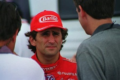 Alex Zanardi (center, pictured in 1998) was involved in a life-threatening accident with 12 laps remaining.