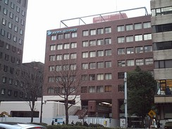 The Avex Building (エイベックスビル, Eibekkusu Biru), finished in 2002 and funded by Sumitomo Life, in Minami-Aoyama, Tokyo. It was vacated in October 2014 to give way to the move to Izumi Garden Tower.